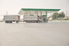 Tolled truck filling diesel fuel from local brand gas station Royalty Free Stock Photography