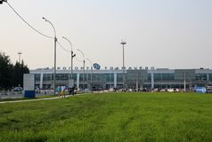 Tolmachevo airport Novosibirsk people passengers go in the summer royalty free stock image
