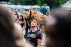 Tolmin, Slovenia - July 25th: Heavy Metal Fans headbanging on the Metaldays Festival on July 24th, 2016 in Tolmin, Slovenia. Heavy Metal Fans headbanging on the Royalty Free Stock Image