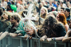 Tolmin, Slovenia - July 25th: Heavy Metal Fans headbanging on the Metaldays on July 24th, 2016 in Tolmin, Slovenia. Heavy Metal Fans headbanging with dreadlocks Royalty Free Stock Photo
