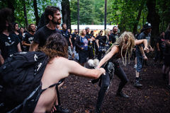 Tolmin, Slovenia - July 25th: Heavy Metal Fans headbanging in a mud on the Metaldays on July 24th, 2016 in Tolmin, Slovenia. Heavy Metal Fans headbanging in a Royalty Free Stock Photo