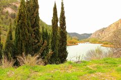 Tolosa reservoir surrounded by vegetation and mountains. In Alcala del Jucar village, Albacete, Spain Stock Images