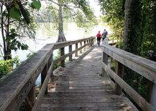 Toltec Mounds - Boardwalk Bridge. Boardwalk Bridge in the Mound Lake, an oxbow lake of the Arkansas River at Toltec Mounds in Scott, Arkansas Stock Photo