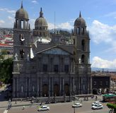 Toluca mexico cathedral. Ancient cathedral in Toluca mexico, church, cathedral made of stone with many religious decoration in the main face of the building Stock Photos