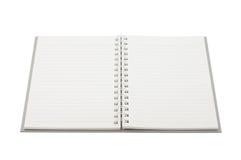 Tom anteckningsbokåtlöje som isoleras upp på vit bakgrund Fästa ihop PA Arkivfoto
