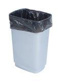 Tom avfallbehållare med den svarta plastpåsen på vit bakgrund Fotografering för Bildbyråer