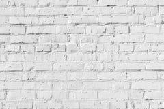 tom bakgrund Texturen av ojämnt murverk Rader av tegelstenar Arkivbilder