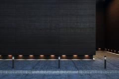 Tom betongvägg för mörker utomhus Arkivfoto
