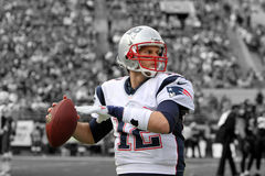 Tom Brady of the New England Patriots. Tom Brady warning up on the sidelines before the game. This is a Spotlight photo Stock Photography