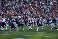 Tom Brady throwing pass. Quarterback Tom Brady, #12,throws pass at Gillette Stadium, the home of Super Bowl champs, New England Patriots, NFL Team play against Royalty Free Stock Images