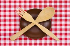 Tom brun plattasked och gaffel Arkivfoto