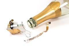 Tom champagneflaska med kork på vit bakgrund royaltyfri fotografi