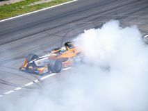Tom Coronel burns some rubber Stock Images