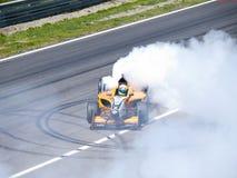 Tom Coronel burns some rubber Stock Image