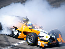 Tom Coronel burns some rubber Royalty Free Stock Photos