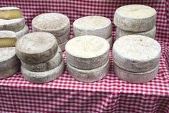Tom de Savoie cheese at the farmer's market. Tom de Savoie cheese for sale at the farmer's market royalty free stock photo