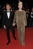 Tom Hiddleston & Tilda Swinton. CANNES, FRANCE - MAY 25, 2013: Tom Hiddleston & Tilda Swinton at gala premiere at the 66th Festival de Cannes for their movie Royalty Free Stock Photo