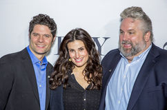 Tom Kitt, Idina Menzel, and Brian Yorkie. Actress and singer Idina Menzel, appearing in the musical, If/Then, arrives at the 2014 Tony Awards Meet the Nominees Royalty Free Stock Image