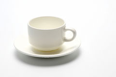 Tom kopp för vitt kaffe på vit bakgrund Arkivfoto