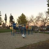 Tom lekplats på solnedgången Royaltyfri Bild