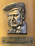 Tom Morris, Jr. Bronze plaques dedicated to Tom Morris, Jr. A professional golfer and 4 time consecutive Open Champion.  Morris is enshrined in the World Golf Royalty Free Stock Photos