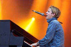 Tom Odell (British singer, songwriter and pianist) sings and plays the piano at FIB Festival. BENICASSIM, SPAIN - JULY 18: Tom Odell (British singer, songwriter royalty free stock photos