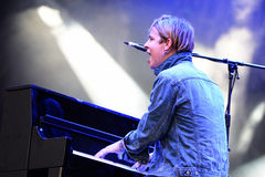 Tom Odell (British singer, songwriter and pianist) sings and plays the piano at FIB Festival. BENICASSIM, SPAIN - JULY 18: Tom Odell (British singer, songwriter Royalty Free Stock Photo