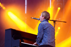 Tom Odell (British singer, songwriter and pianist) sings and plays the piano at FIB Festival Stock Photo