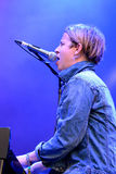 Tom Odell (British singer, songwriter and pianist) sings and plays the piano at FIB Festival Stock Photos