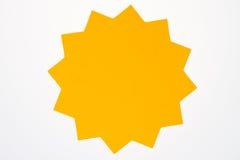Tom orange stjärnabristning som isoleras på vit. Arkivfoton