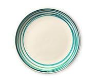 Tom platta med blåttmodellkanten, keramisk platta med den spiral modellen i vattenfärgstilar som isoleras på vit bakgrund fotografering för bildbyråer