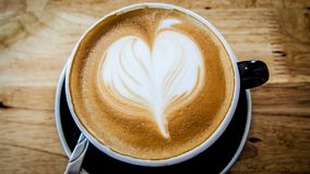 Tom quente do marrom da arte do latte do café Imagem de Stock Royalty Free