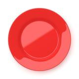 Tom röd keramisk rund platta som isoleras på vit arkivfoto