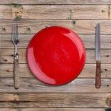 Tom röd platta royaltyfria foton
