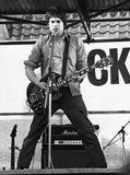 The Tom Robinson Band. Danny Kustow, guitarist with British pop group The Tom Robinson Band, performs live in London on April 30, 1978 Stock Images