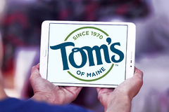 Tom`s of Maine logo. Logo of personal care products company Tom`s of Maine on samsung tablet royalty free stock image
