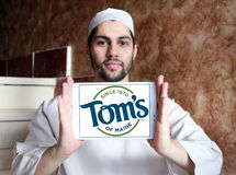 Tom`s of Maine logo. Logo of personal care products company Tom`s of Maine on samsung tablet holded by arab muslim man stock images