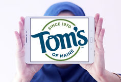 Tom`s of Maine logo. Logo of personal care products company Tom`s of Maine on samsung tablet holded by arab muslim woman stock images