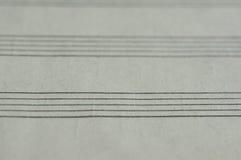 Tom sida i en musikbok Arkivfoton