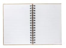 Tom spiralanteckningsbok som är öppen på vit Fotografering för Bildbyråer