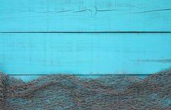 Tom turkos åldrats trätecken med gränsen för fisk netto Fotografering för Bildbyråer