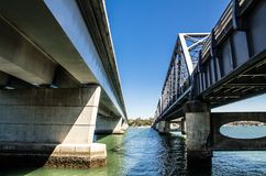 Tom Uglys Bridge is pratt truss spans that is composed of two bridges, cross the Georges River in southern Sydney. The Tom Uglys Bridge is pratt truss spans stock photography