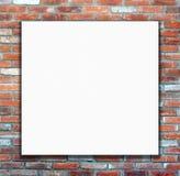 Tom vit affisch på bakgrund för tegelstenvägg Fotografering för Bildbyråer
