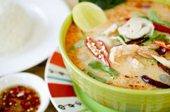 Tom Yam Kong (Thai cuisine). With rice on white plate Stock Photos
