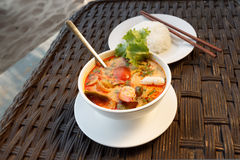 Tom Yam seafood soup served with rice Stock Image