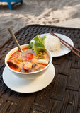 Tom Yam seafood soup served with rice Stock Photos