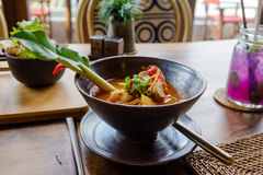 Tom yam soup with a drink Royalty Free Stock Photo