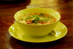 Tom yam spicy sooup. Tom yam thai seafood soup closeup on wooden table Royalty Free Stock Image