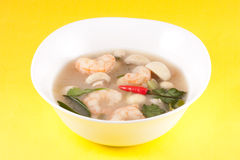 Tom Yam - Thai Soup. Soup originating from Thailand, with prawn, mushrooms, coriander, Kafir lime leaves and chili peppers Royalty Free Stock Images