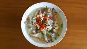 Tom yum goong, spicy shrimp soup, famous Thai food  on b Stock Photography